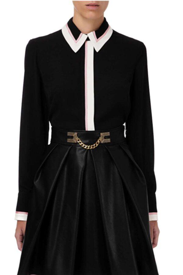 Raffinata e versatile la camicia proposta per la collezione donna Elisabetta Franchi.  I dettagli in contrasto di colore donano un look frizzante e delicato.  Da indossare con pantaloni o gonne è un capo senza tempo.